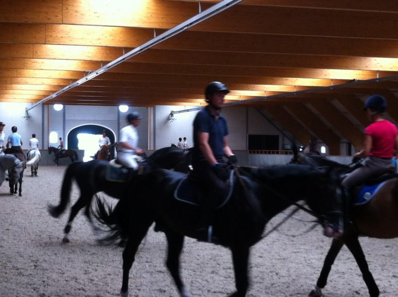 01-08-2013 Riders training the horses in the cool Indoor Arena